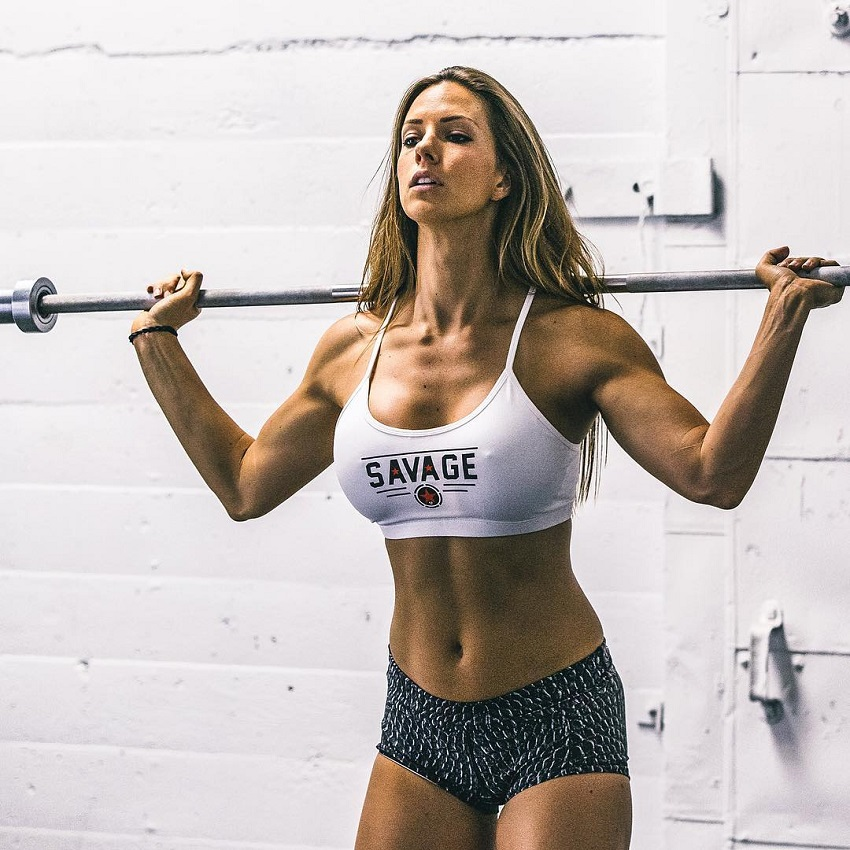 Janna Breslin training hard in the gym using her fit and strong muscles