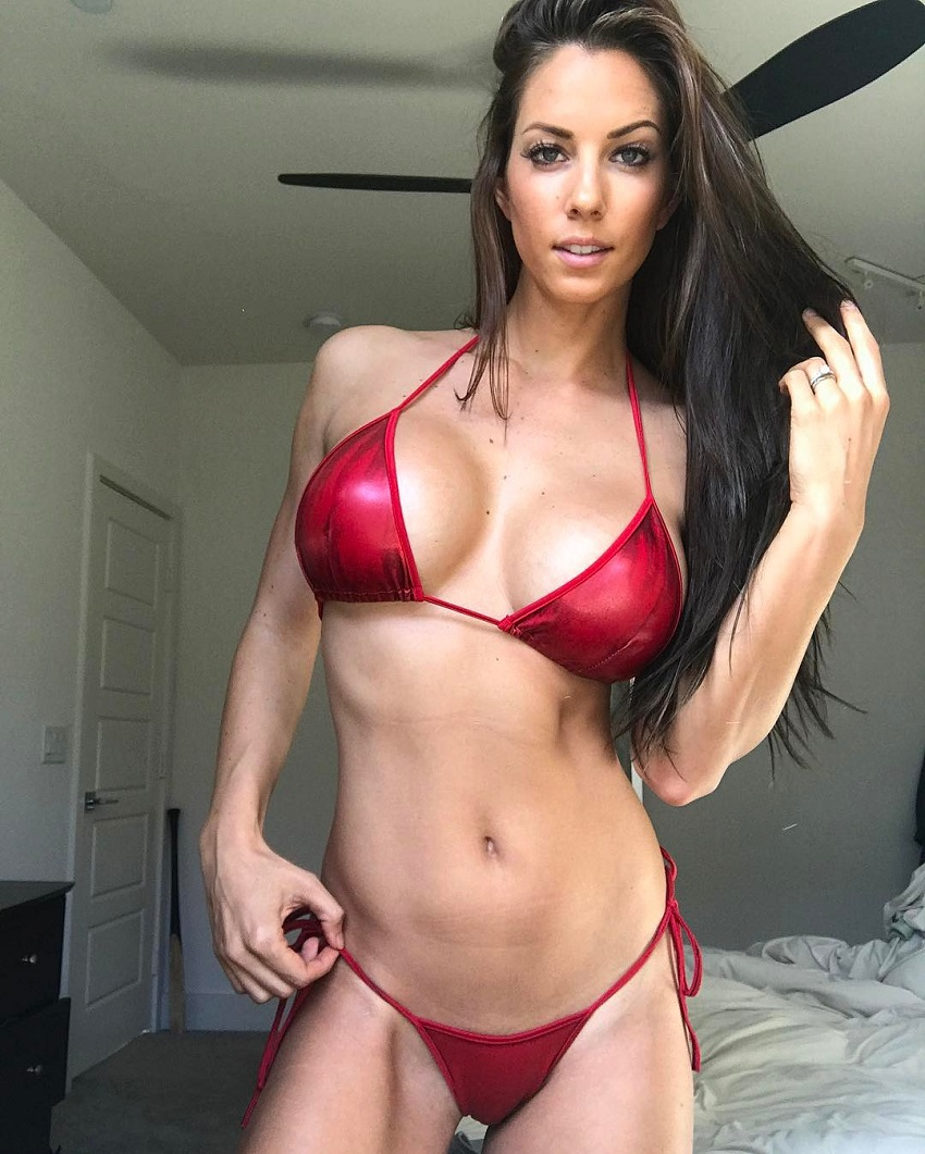 Janna Breslin posing for a fitness picture in a red bikini
