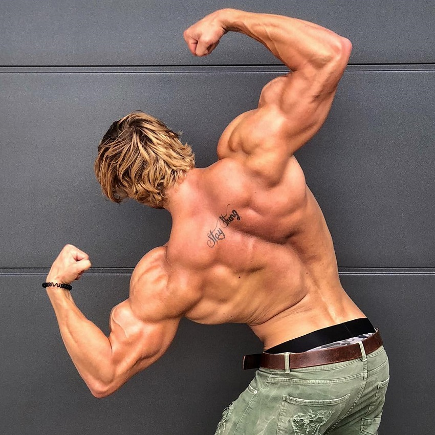Jo Linder doing a back double biceps pose looking strong and aesthetic