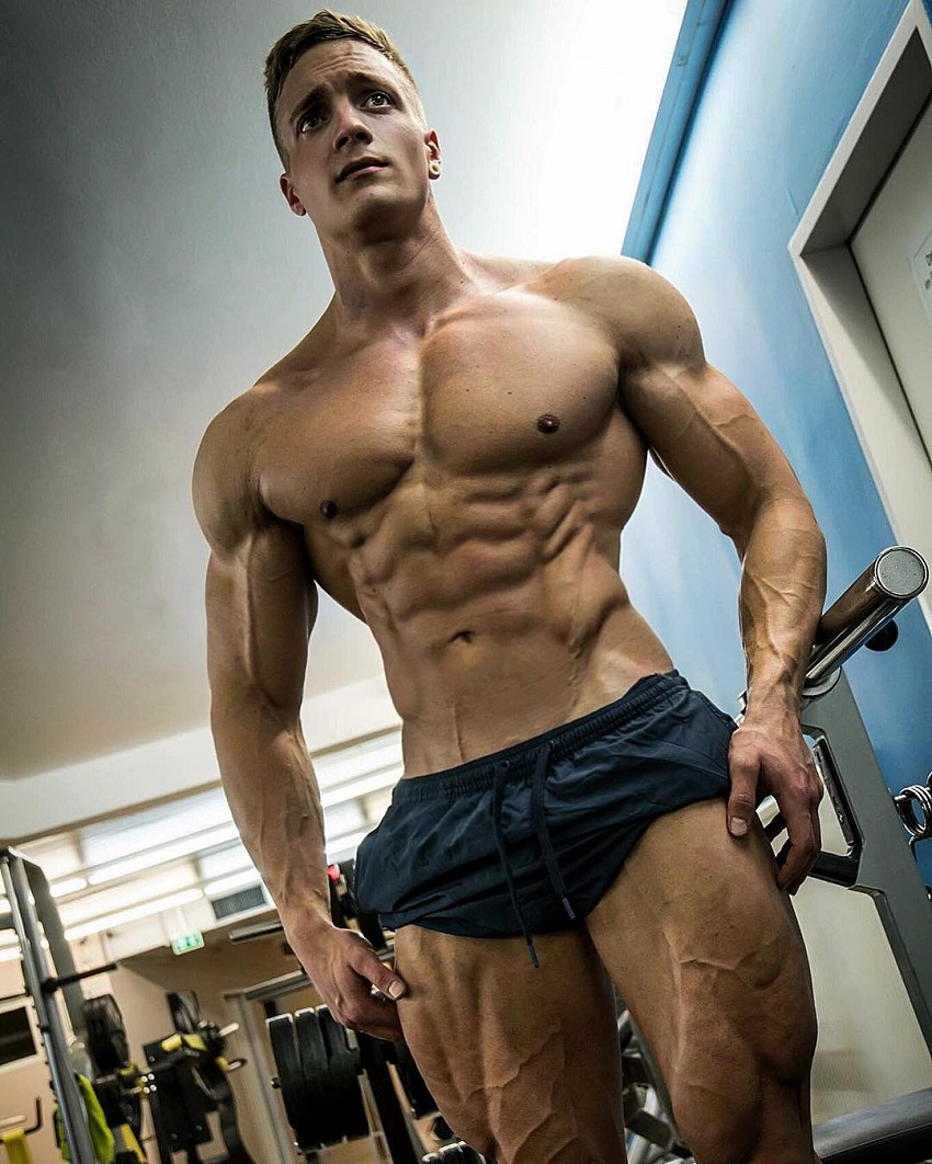 Jo Linder showing off his shirtless, muscular, and ripped upper body for the photo