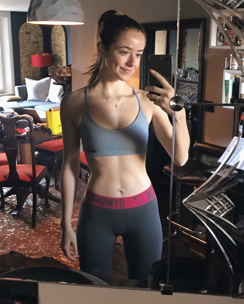 Molly Teshuva taking a selfie of her ripped midsection