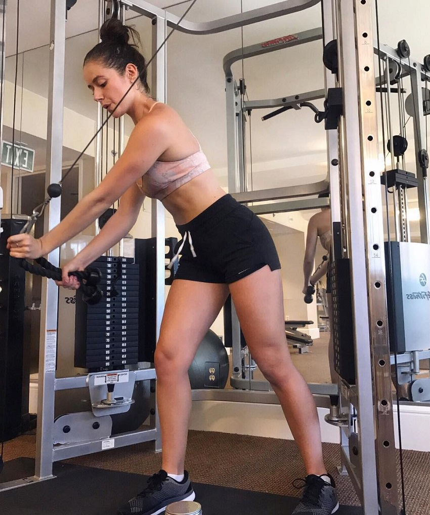 Molly Teshuva training with cables in the gym