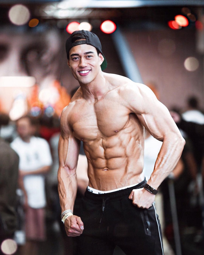 Nam Vo flexing shirtless for the photo looking ripped