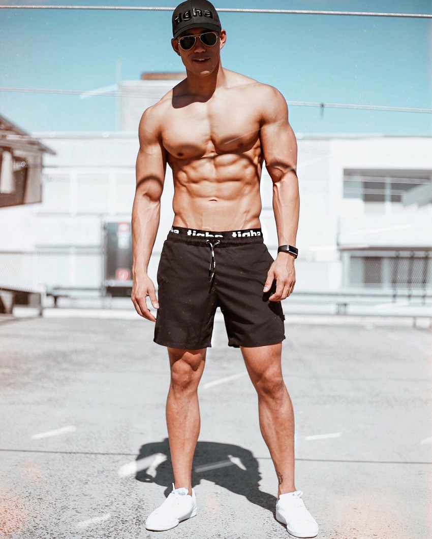 Nam Vo posing shirtless for the camera looking fit and strong