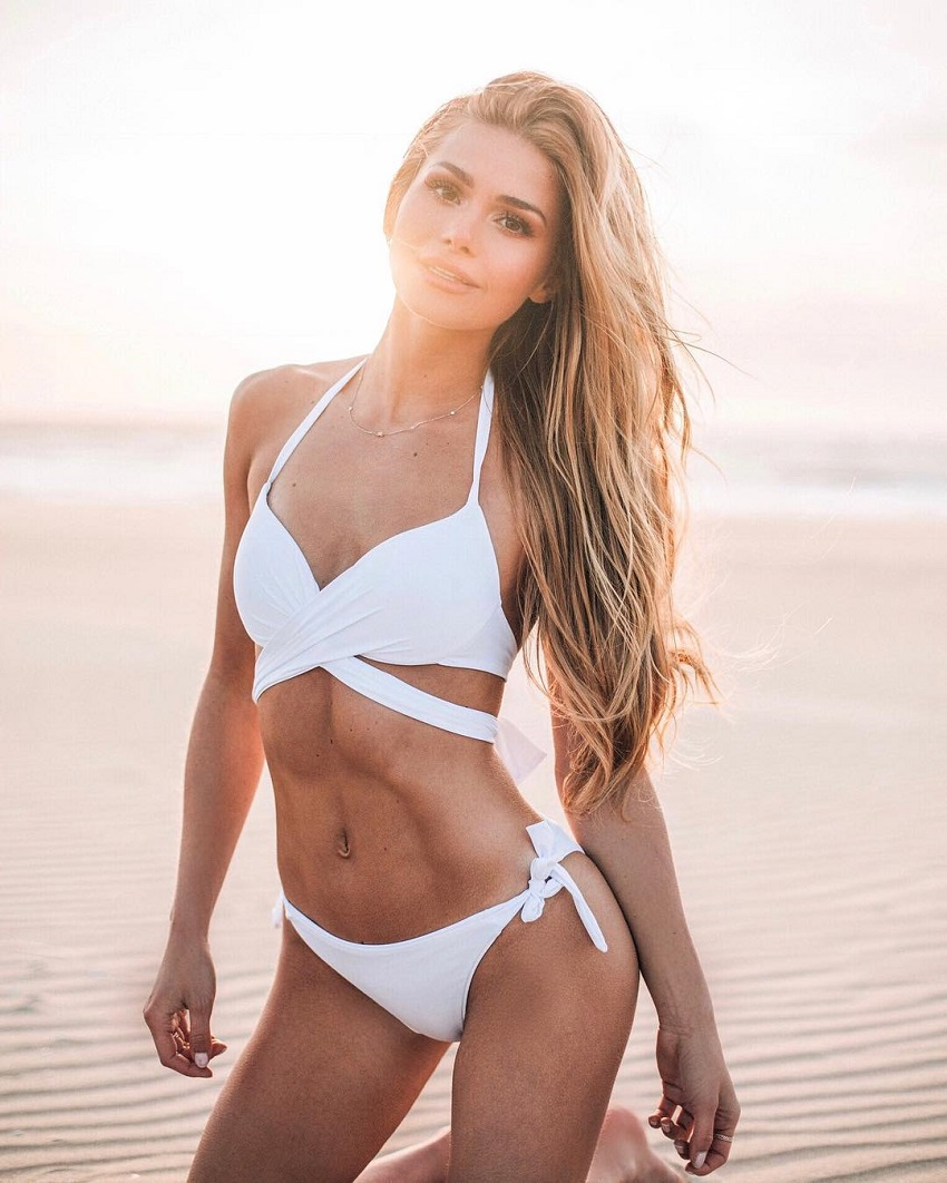 Pamela Reif posing in her white bikini looking fit and toned