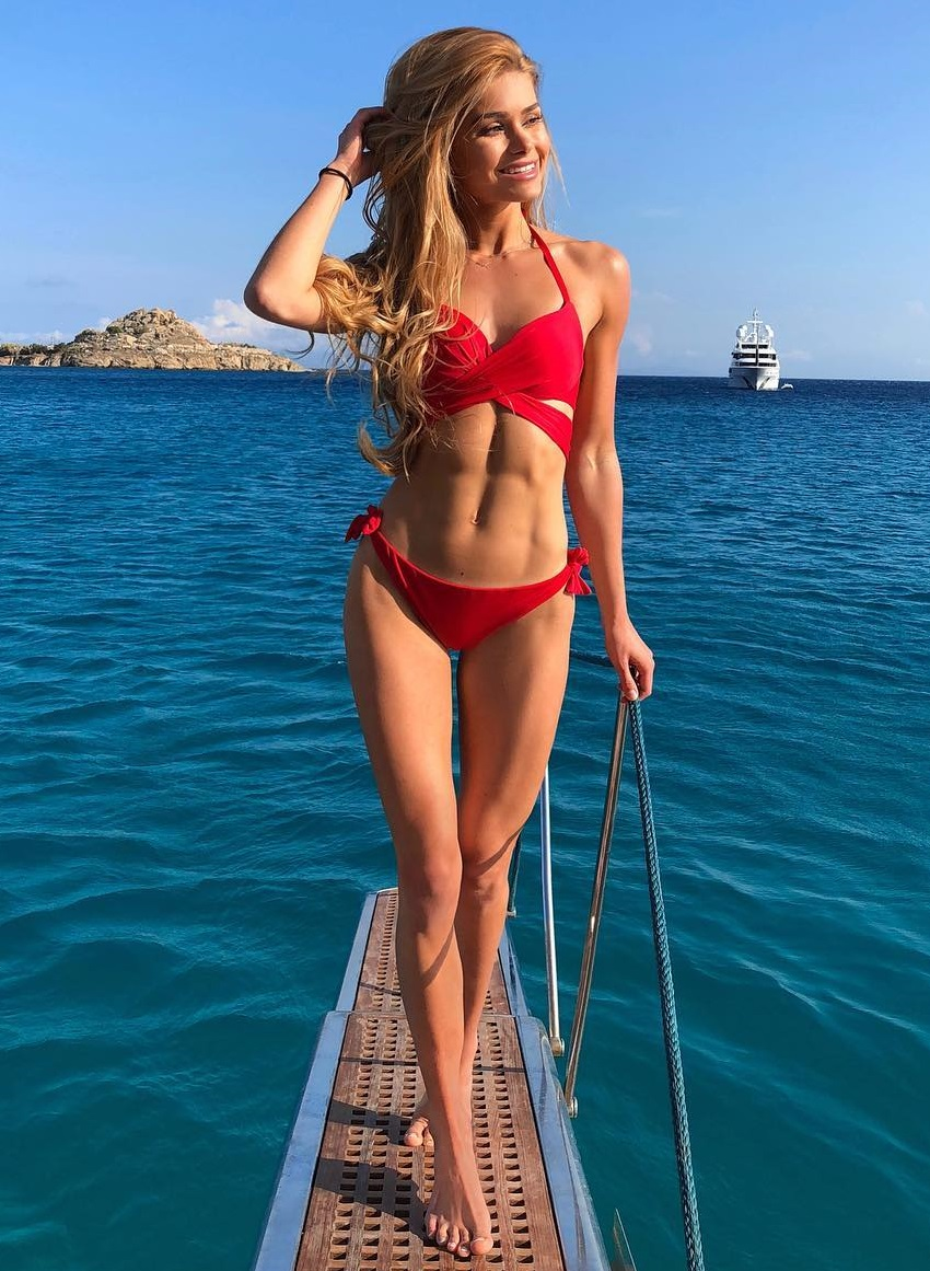 Pamela Reif displaying her awesome physique in a red bikini