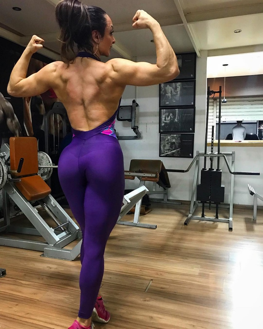 Pri Santtana doing a back double biceps flex, practicing posing for a contest