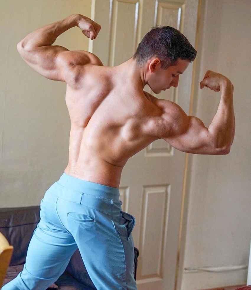 Radoslav Raychev doing a back double biceps pose for a photo