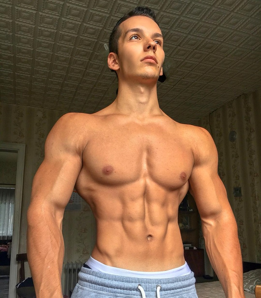 Radoslav Raychev posing shirtless for a photo looking ripped and muscular