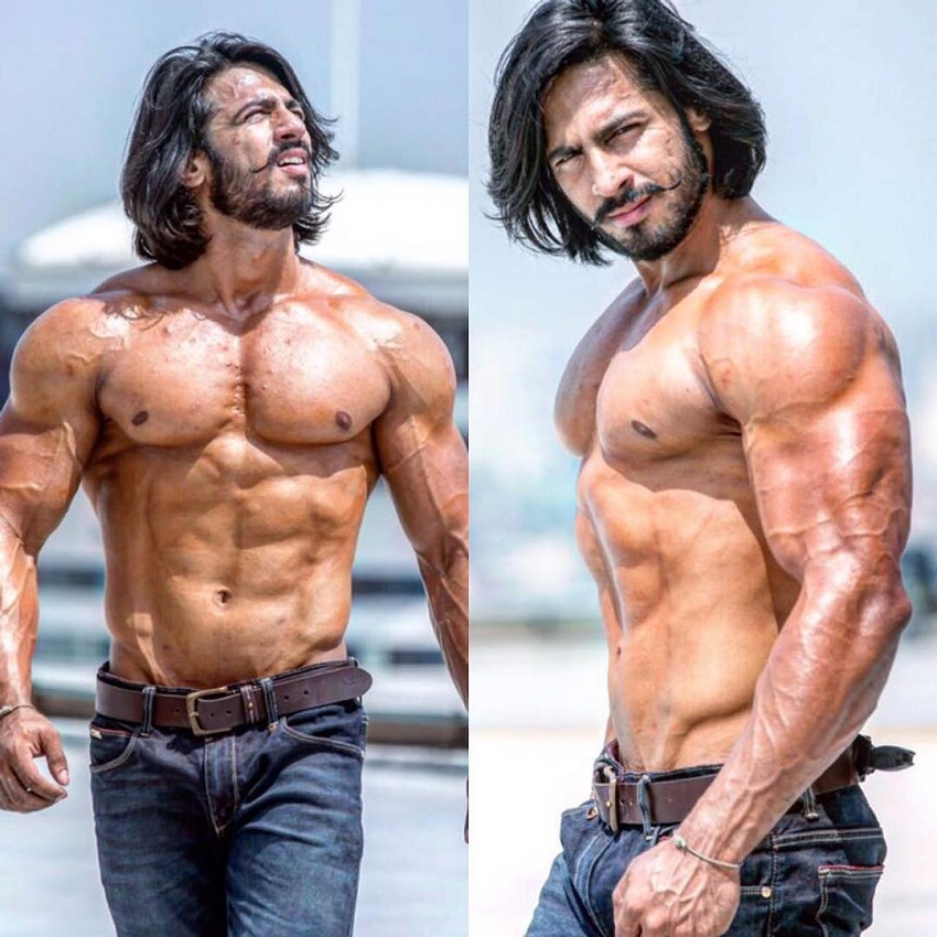 Thakur Anoop Singh walking shirtless outdoors looking big and ripped