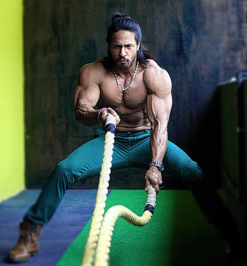 Thakur Anoop Singh doing battle ropes looking healthy and strong