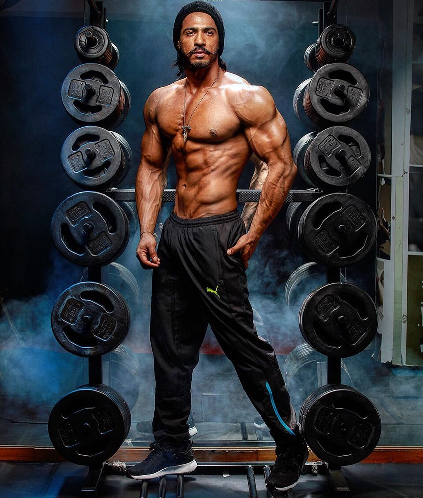 Thakur Anoop Singh posing for the photo looking ripped and strong