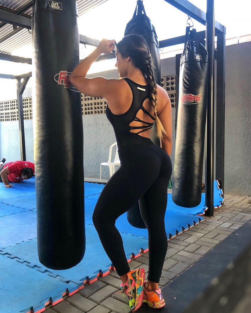Amanda Choairy standing next to a boxing bag practicing her moves