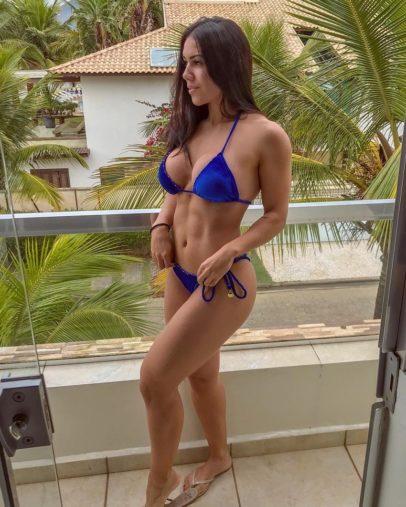 Andressa Gil posing for a picture in a black bikini