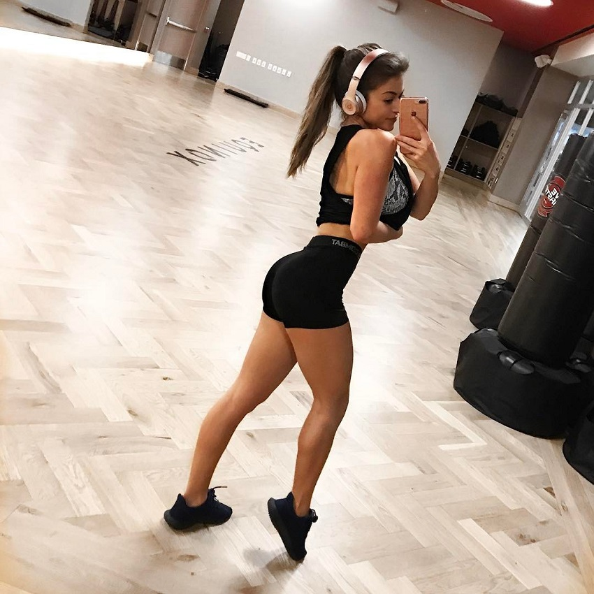 Angelica Kathleen taking a picture of herself in a training room