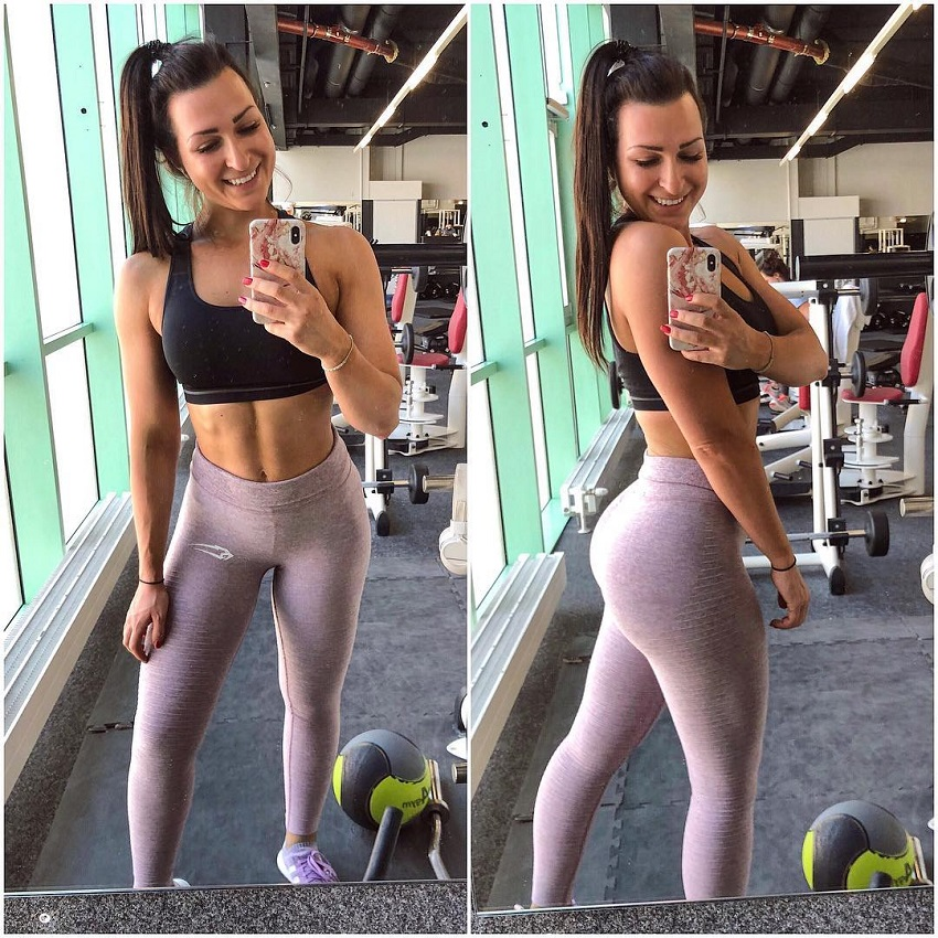 Eva Saischegg taking a selfie of her toned body in grey leggings in a gym