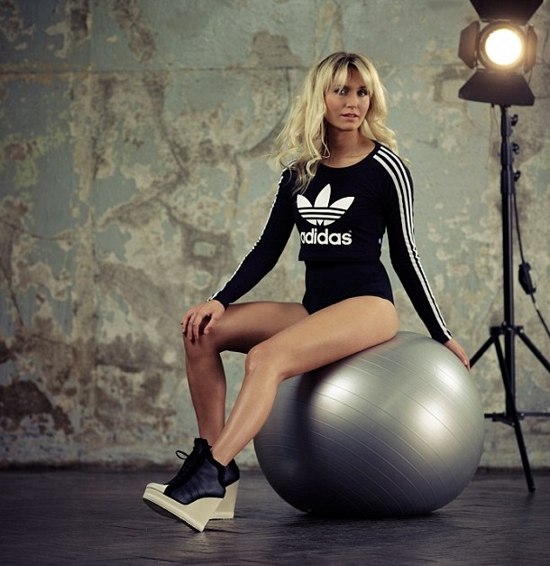 Faya Nilsson posing in a photo shoot while sitting on a yoga ball