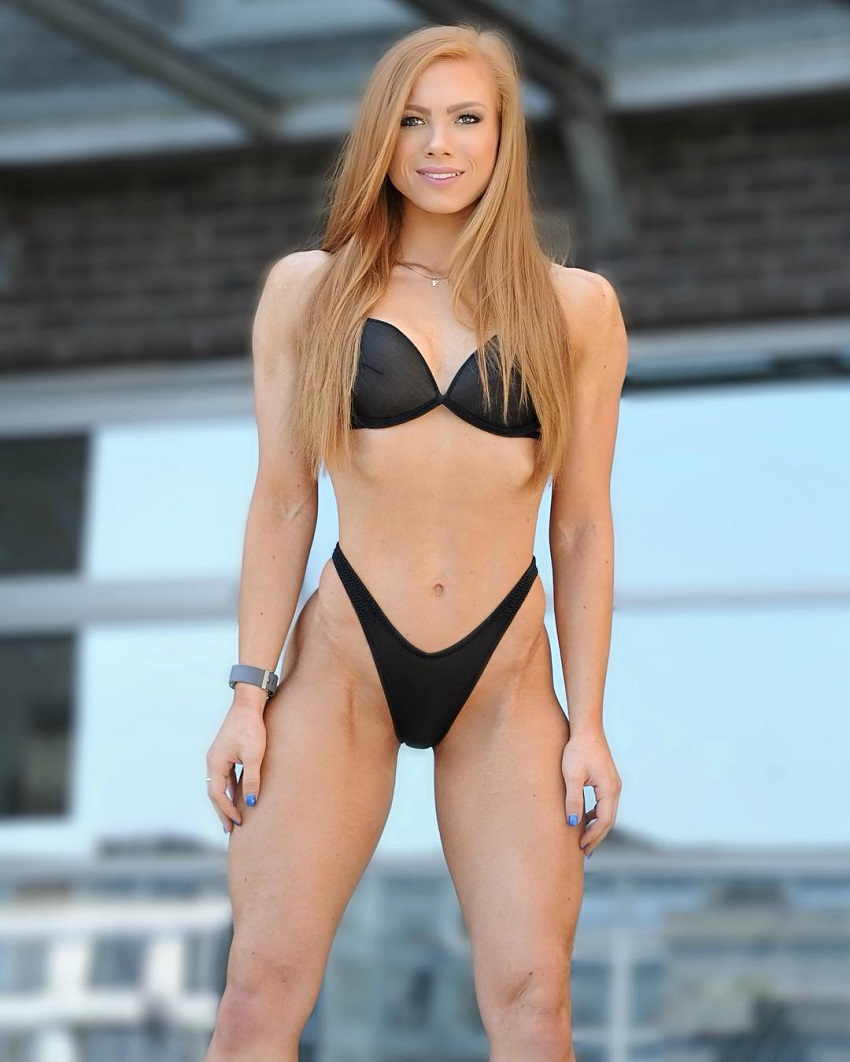 Franziska Lohberger posing in a black bikini displaying her immaculate physique
