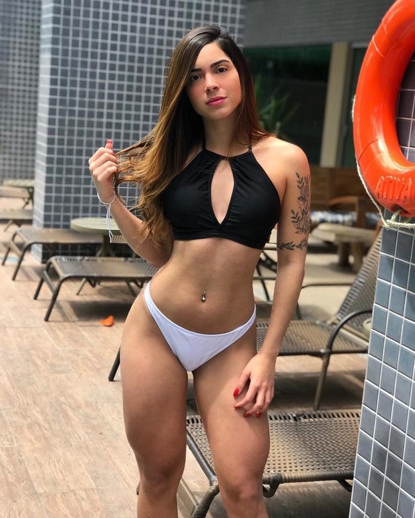 Luana Targino wearing a black and white bikini looking fit and lean