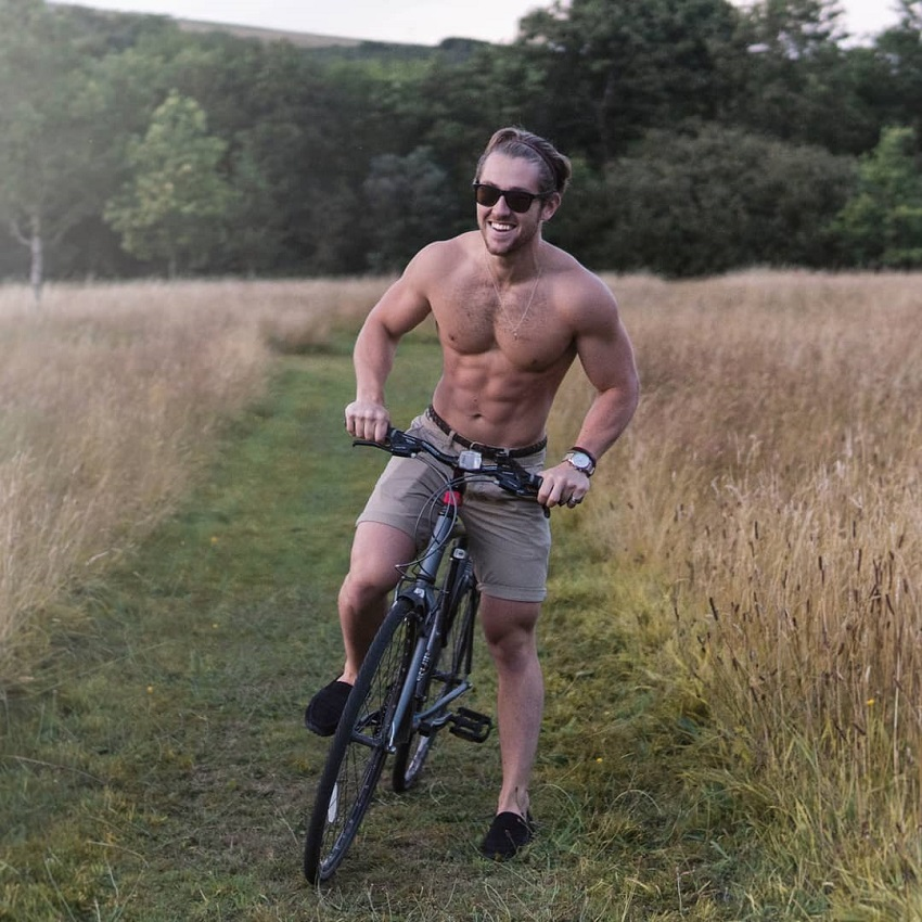 Matt Lucas looking ripped on his bike in nature