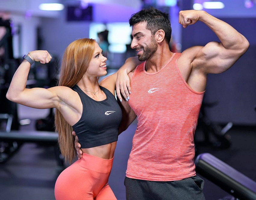 Murat Demir posing with Franziska Lohberger in a gym