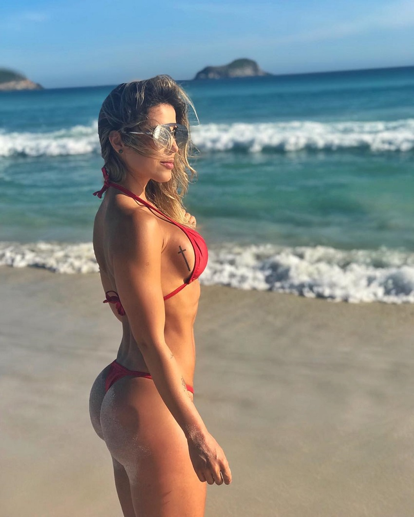 Sabrina Toledo posing by a beach looking curvy