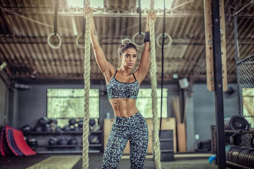 Sabrina Toledo hanging on ropes looking fit and lean