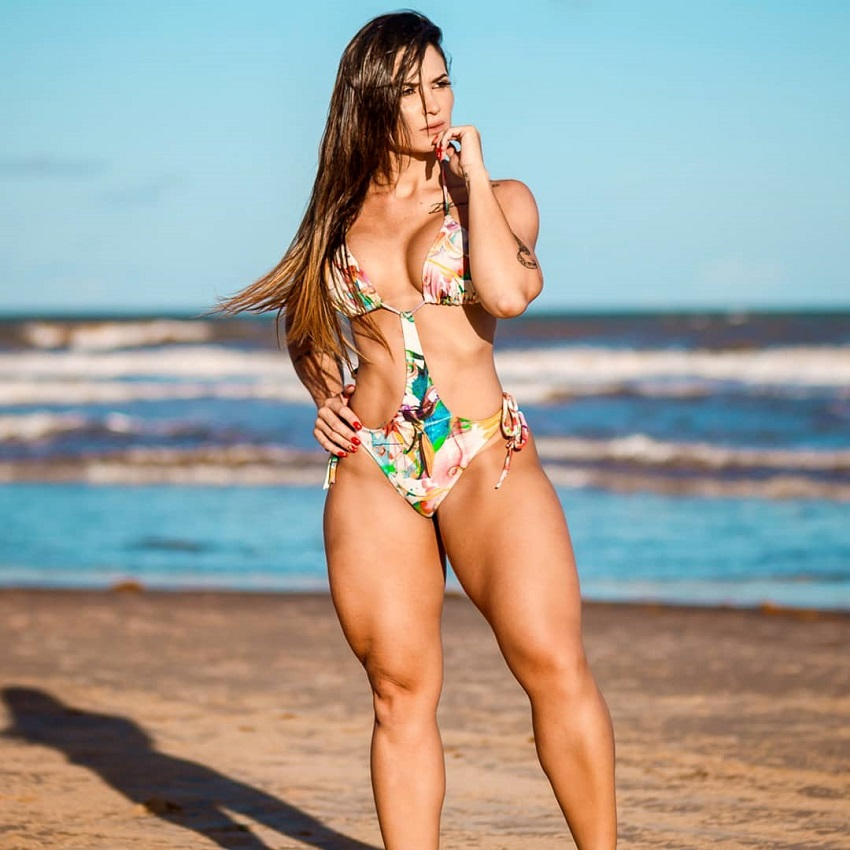 Sol Meneghini posing on a beach looking strong and fit