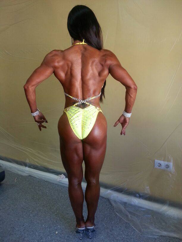 Sonia Amat Sánchez posing with her muscular back before a competition