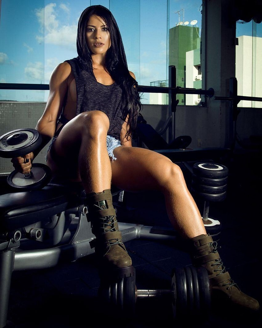 Yasmin Castrillon posing with dumbbells looking lean and fit