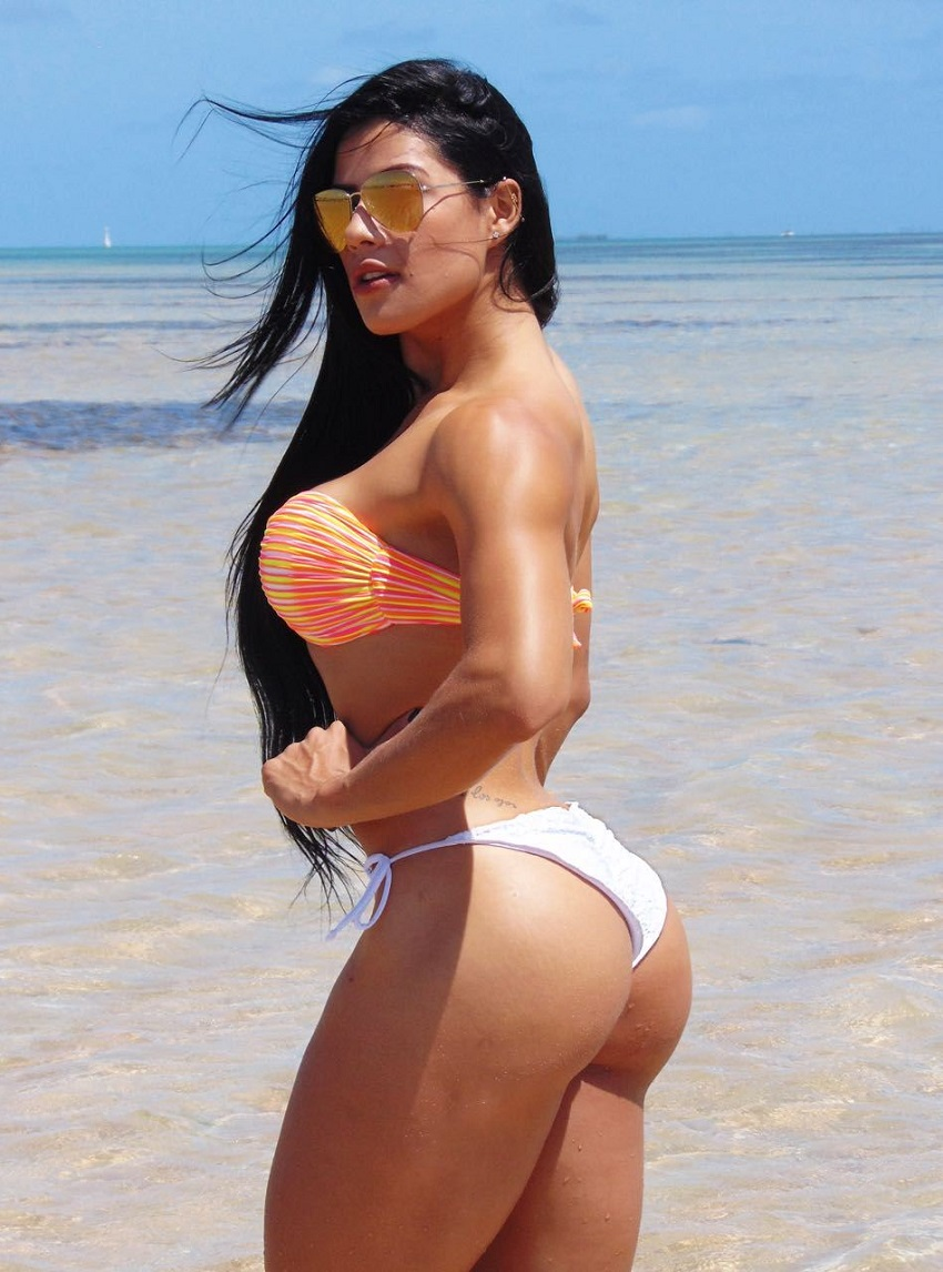Yasmin Castrillon posing by the beach displaying her awesome and curvy figure