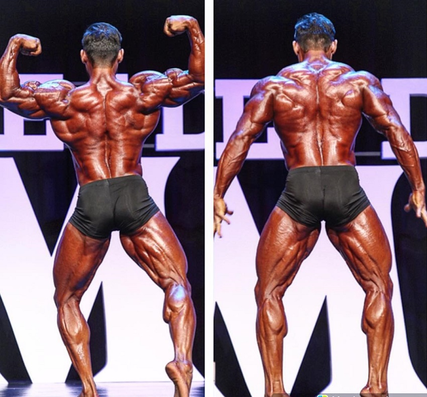 Abtin Shekarabi posing on the Mr. Olympia Bodybuilding Stage looking huge and ripped