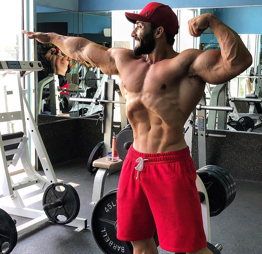 Abtin Shekarabi flexing in the gym looking strong and lean