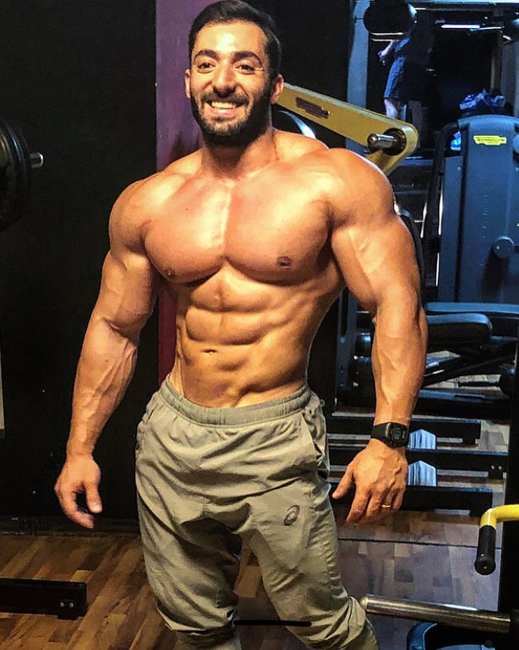 Abtin Shekarabi posing for a picture looking muscular and ripped