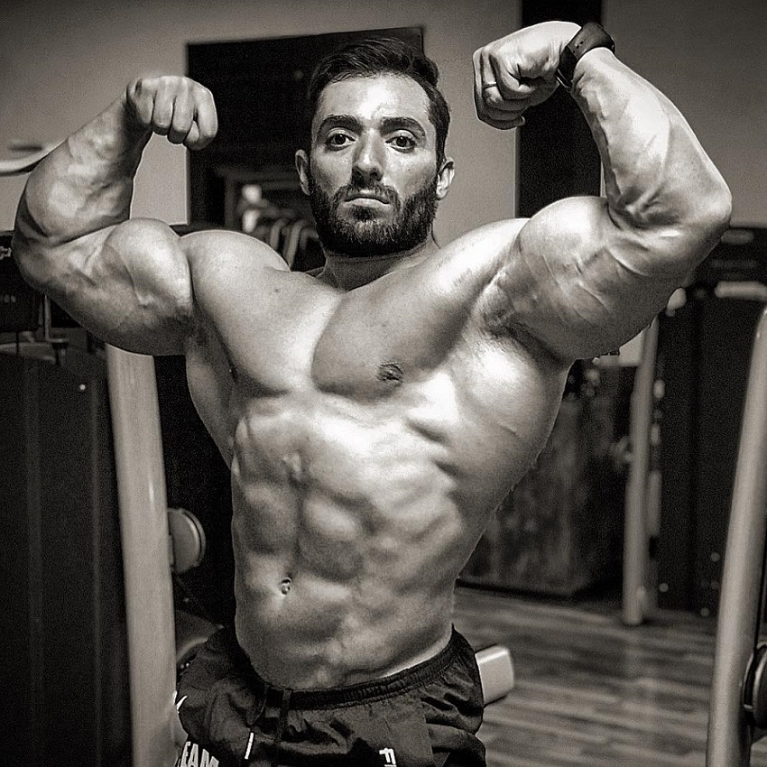 Abtin Shekarabi performing a front double biceps flex