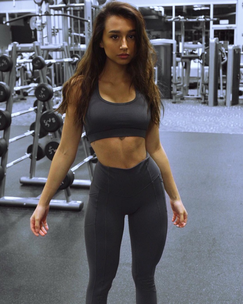Amber Gianna posing for the camera in a gym