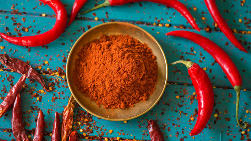 Chili pepper powder on a blue table