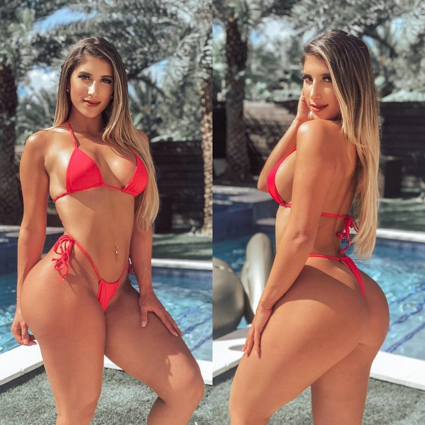 Isabella Buscemi posing by a pool in a red bikini