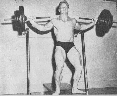 Jack Delinger training with a heavy barbell on his back in bodybuilding