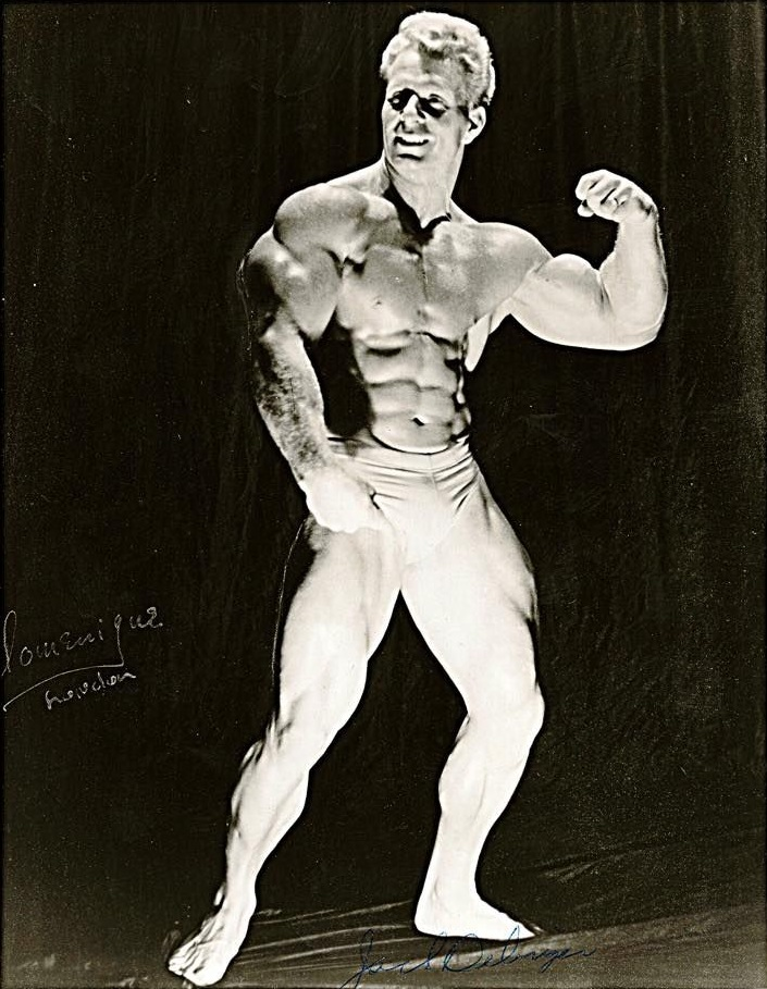 Jack Delinger posing in a bodybuilding competition