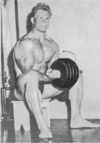 Jack Delinger lifting heavy weights shirtless
