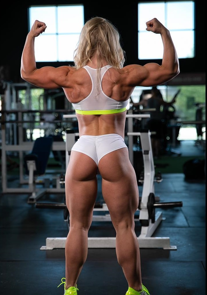 Jazmin Gillespie doing a back double biceps pose looking curvy and strong