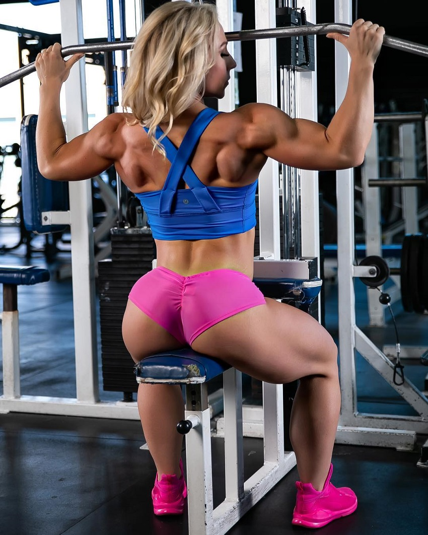 Jazmin Gillespie training her lats on a machine