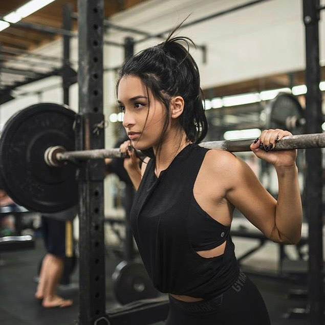 Jazmine Garcia performing heavy squats looking curvy and fit