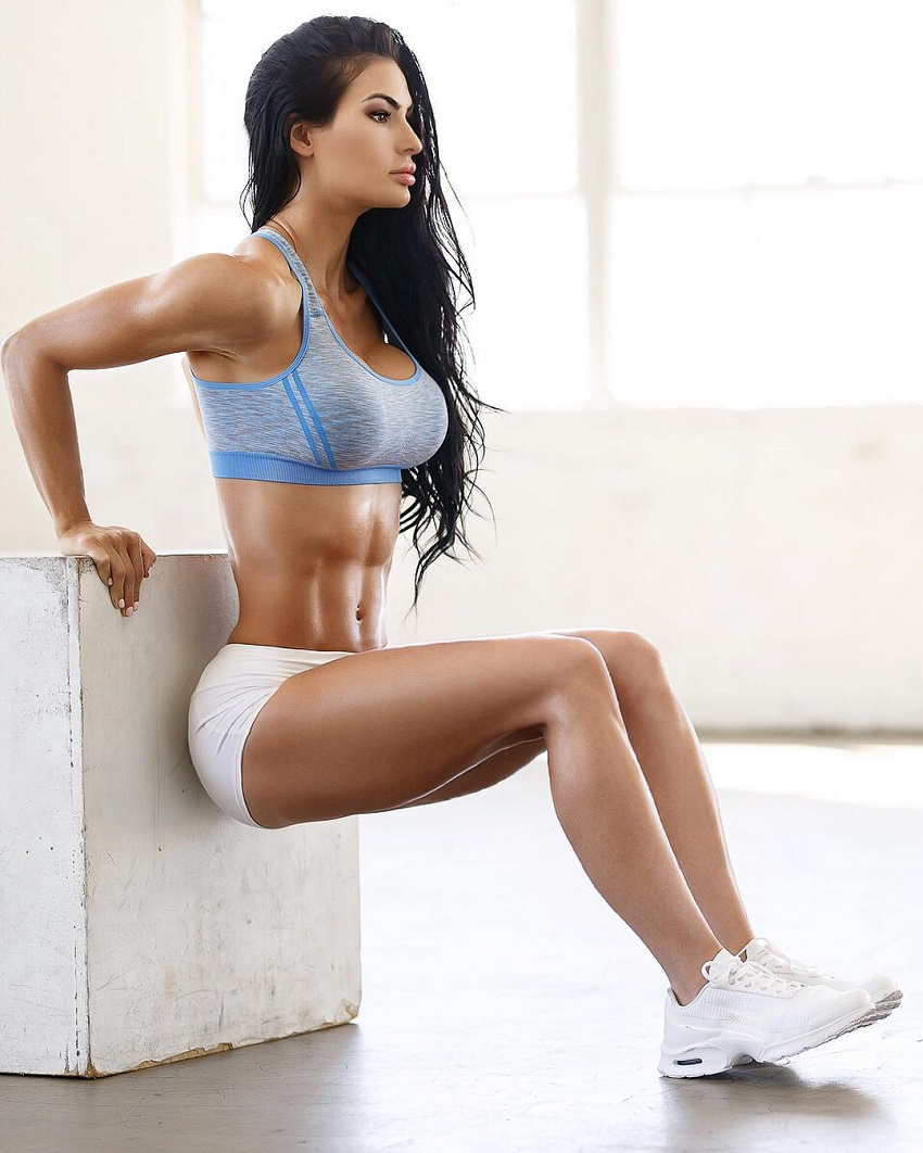 Katelyn Runck exercising in an empty room looking fit and toned