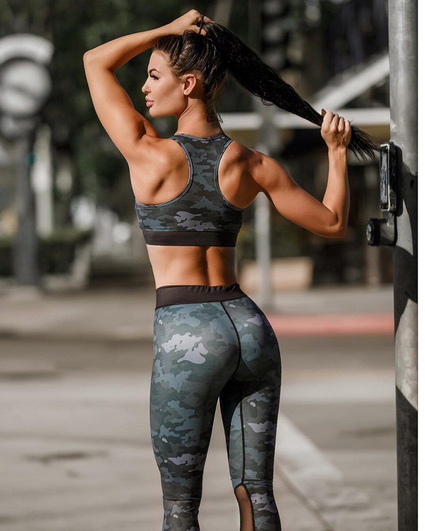 Katelyn Runck posing in an outdoors gym looking fit and lean