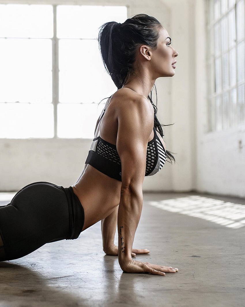 Katelyn Runck Stretching looking lean