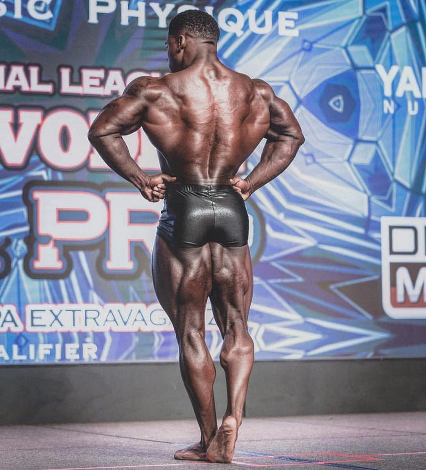 Keone Pearson performing a rear lat spread on the bodybuilding stage
