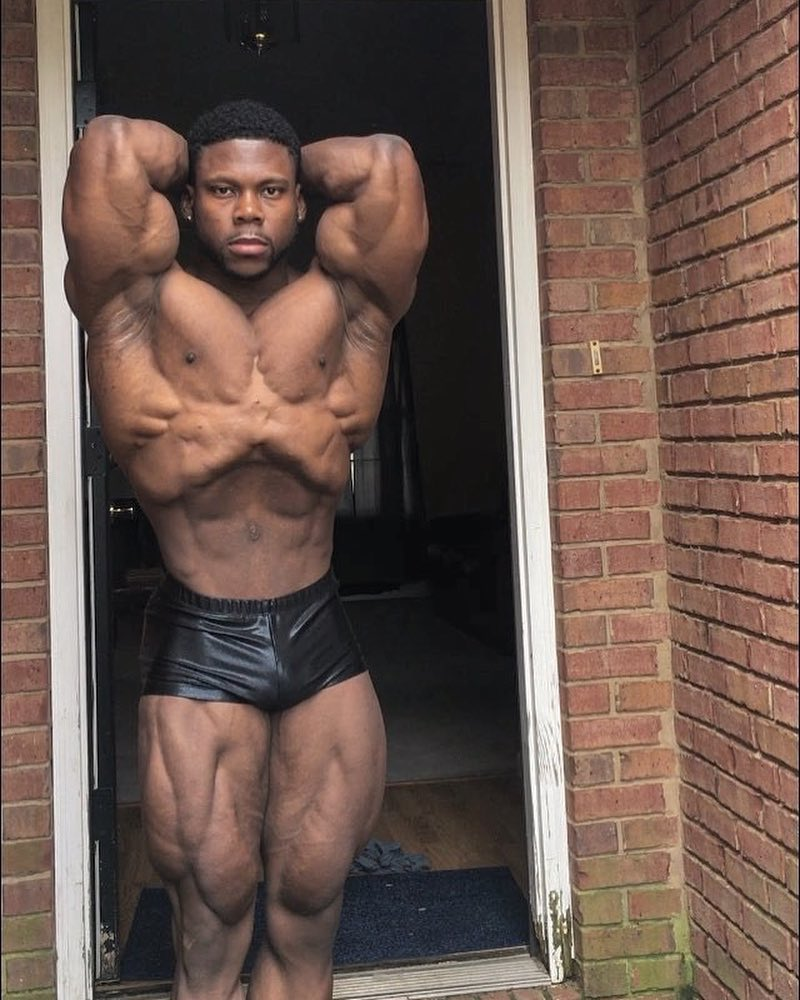 Keone Pearson flexing his bulging and ripped muscles for the camera