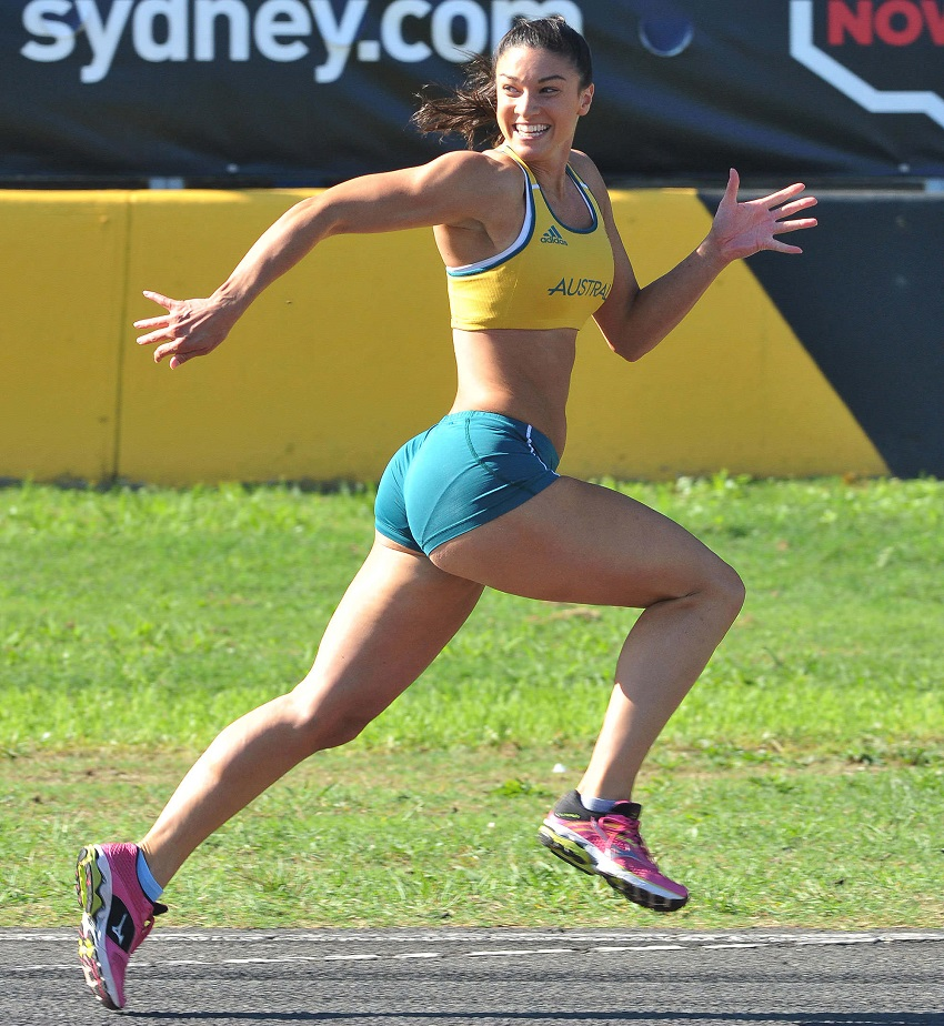 Michelle Jenneke running and smiling